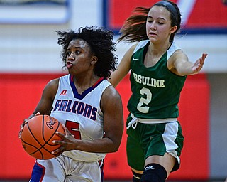AUSTINTOWN, OHIO - DECEMBER 5, 2018: Fitch's Jada Lazaro looks to pass after dribbling past Ursuline's Rachel Fabry during the first half of their game, Wednesday night at Austintown Fitch High School. DAVID DERMER | THE VINDICATOR