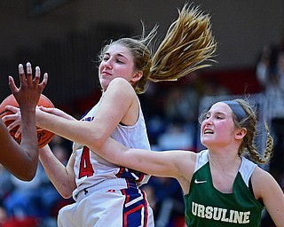 AUSTINTOWN, OHIO - DECEMBER 5, 2018: Fitch's Emma Bartlett pulls a rebound away from Ursuline's Jamie Nelson during the second half of their game, Wednesday night at Austintown Fitch High School. DAVID DERMER | THE VINDICATOR