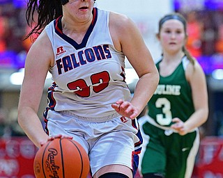AUSTINTOWN, OHIO - DECEMBER 5, 2018: Fitch's Sabrina Hunter dribbles ahead of Ursuline's Jamie Nelson during the second half of their game, Wednesday night at Austintown Fitch High School. DAVID DERMER | THE VINDICATOR