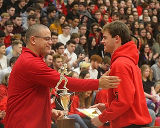 William D. Lewis The Vindicator   Girard AD Nick Cochran presents  junior Nick Malito with a medal during a 12-6-18 event at Girard HS honoring the 2018 state runners up football team.