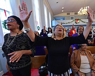 YOUNGSTOWN, OHIO - JANUARY 1, 2019: Carol Griffin from Youngstown, left, and Linda Jenkins from Youngstown, right, sing, Tuesday morning during the Community Emancipation Proclamation & Installation of Officers Service at Calvary Baptist Church. DAVID DERMER | THE VINDICATOR