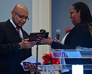 YOUNGSTOWN, OHIO - JANUARY 1, 2019: Dr. Robin Woodberry, right, presents Rev. Kenneth L. Simon with the Powell Heritage Award, Tuesday morning during the Community Emancipation Proclamation & Installation of Officers Service at Calvary Baptist Church. DAVID DERMER | THE VINDICATOR