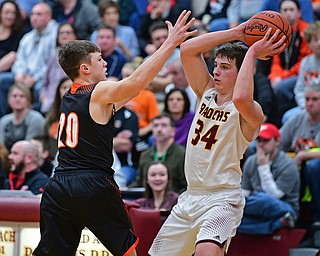 CANFIELD, OHIO - JANUARY 2, 2019: South Range's Chris Brown looks to pass while being pressured by Springfield's Beau Brungard during the second half of their game, Wednesday night at South Range High School. DAVID DERMER   THE VINDICATOR