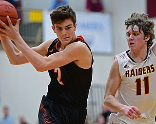 CANFIELD, OHIO - JANUARY 2, 2019: Springfield's Drew Clark drives on South Range's Dante DiGaetano during the second half of their game, Wednesday night at South Range High School. DAVID DERMER   THE VINDICATOR