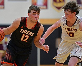 CANFIELD, OHIO - JANUARY 2, 2019: Springfield's Shane Eynon drives on South Range's Chris Brooks during the second half of their game, Wednesday night at South Range High School. DAVID DERMER   THE VINDICATOR