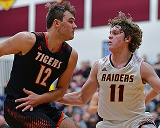 CANFIELD, OHIO - JANUARY 2, 2019: Springfield's Shane Eynon goes to the basket against South Range's Dante DiGaetano during the second half of their game, Wednesday night at South Range High School. DAVID DERMER   THE VINDICATOR