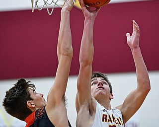CANFIELD, OHIO - JANUARY 2, 2019: South Range's Nick Matos puts up a shot over Springfield's Drew Clark during the second half of their game, Wednesday night at South Range High School. DAVID DERMER   THE VINDICATOR