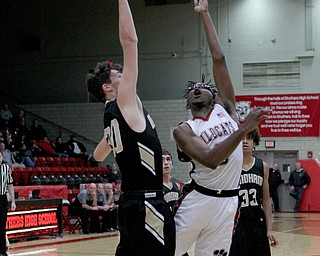 Kevin Traylor (3) of Struthers is closely defended by Bailey Rutherford (30) of Windham as he puts up a layup during Wednesday nights matchup at Struthers High School.  Dustin Livesay  |  The Vindicator  1/2/19  Struthers