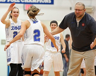 Poland's Jackie Grisdale, left, and Coach Nick Blanch high-five Sarah Bury after she scores against Mooney during their game at Poland on Thursday night. EMILY MATTHEWS | THE VINDICATOR