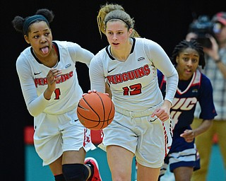 YOUNGSTOWN, OHIO - JANUARY 3, 2018: Youngstown State's Chelsea Olson dribbles away from Illinois-Chicago's Jasmine Gaines after forcing a turnover during the second half of their game, Thursday night Beeghley Center. Youngstown State won 81-29. DAVID DERMER | THE VINDICATOR