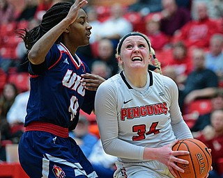 YOUNGSTOWN, OHIO - JANUARY 3, 2018: Youngstown State's McKenah Peters goes to the basket against Illinois-Chicago's Jasmine Gaines during the first half of their game, Thursday night Beeghley Center. Youngstown State won 81-29. DAVID DERMER | THE VINDICATOR