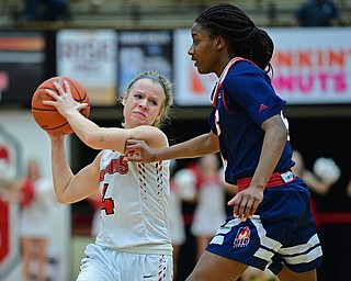 YOUNGSTOWN, OHIO - JANUARY 3, 2018: Youngstown State's Melinda Trimmer puts a move on to avoid Illinois-Chicago's Jasmine Gaines during the first half of their game, Thursday night Beeghley Center. Youngstown State won 81-29. DAVID DERMER | THE VINDICATOR
