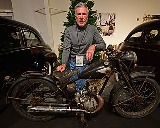 WARREN, OHIO - JANUARY 4, 2018: William Alford,of Canton, poses for a portrait with his Royal Enfield  Flying Flea during the preview party for 19th annual vintage motorcycle exhibit at the National Packard Museum. DAVID DERMER | THE VINDICATOR
