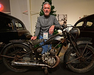 WARREN, OHIO - JANUARY 4, 2018: William Alford, of Canton, poses for a portrait with his Royal Enfield  Flying Flea during the preview party for 19th annual vintage motorcycle exhibit at the National Packard Museum. DAVID DERMER | THE VINDICATOR