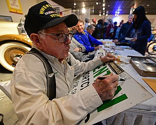 WARREN, OHIO - JANUARY 4, 2018: John Penton, of Amherst, Ohio, signs an autograph for a fan during the preview party for 19th annual vintage motorcycle exhibit at the National Packard Museum. DAVID DERMER | THE VINDICATOR