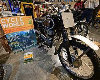 WARREN, OHIO - JANUARY 4, 2018: A motorcycle that was driven by Jack Penton, featured on the magazine cover to the left, on display during the preview party for 19th annual vintage motorcycle exhibit at the National Packard Museum. DAVID DERMER | THE VINDICATOR