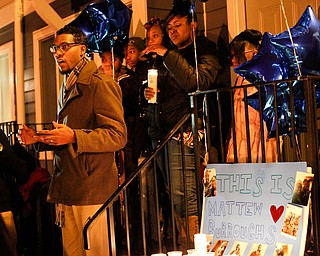 Pastor Todd Johnson of Second Baptist Church in Warren speaks at a vigil for Matthew Burroughs outside of Burroughs' Royal Mall Apartment on Saturday night. EMILY MATTHEWS | THE VINDICATOR