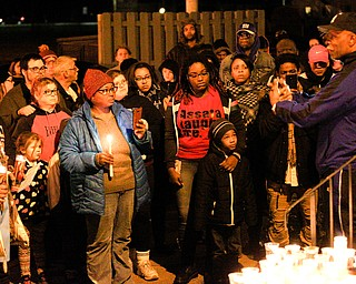 People gather for a vigil for Matthew Burroughs outside of Burroughs' Royal Mall Apartment on Saturday night. EMILY MATTHEWS | THE VINDICATOR