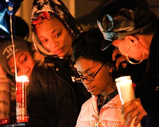 Jayla Burroughs, 8, the daughter of Matthews Burroughs, speaks at a vigil for her father outside of his Royal Mall Apartment on Saturday night. EMILY MATTHEWS | THE VINDICATOR