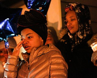 Ashantee Allen, 15, of Warren, speaks about her relationship with Matthew Burroughs as well as how she will miss seeing how happy Burroughs made her mom, Tara Elkins, who is standing behind her, at a vigil for Burroughs outside of his Royal Mall Apartment on Saturday night. EMILY MATTHEWS | THE VINDICATOR