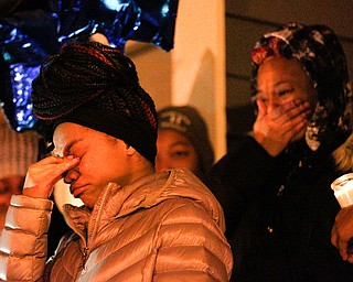 Ashantee Allen, 15, of Warren, pauses while speaking about her relationship with Matthew Burroughs as well as how she will miss seeing how happy Burroughs made her mom, Tara Elkins, who is standing behind her, at a vigil for Burroughs outside of his Royal Mall Apartment on Saturday night. EMILY MATTHEWS | THE VINDICATOR