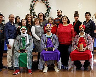 Volunteers and organizers of the Three Kings Day at OCCHA including the Three Kings, from left, Jose Rene Vazquez, Carlos Rosario, and George Lopez, all of Youngstown, pose for a photo after the kings distribute presents to children on Saturday afternoon. EMILY MATTHEWS | THE VINDICATOR