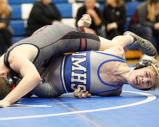 Jackson Milton's Austin Stanke, bottom, and Salem's Tony Seddon wrestle during the Jackson-Milton Invitational finals on Saturday. EMILY MATTHEWS | THE VINDICATOR