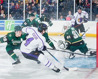 Scott R. Galvin   The Vindicator.Youngstown Phantoms defenseman Nikolai Jenson (4) scores a goal against Sioux City Musketeers goalie Jake Sibell (31) during the first period at the Covelli Centre on Saturday, January 5, 2019.