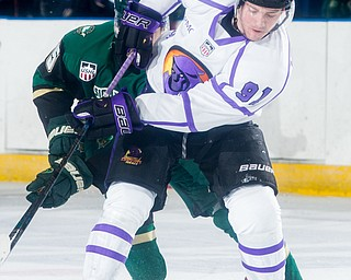 Scott R. Galvin   The Vindicator.Youngstown Phantoms forward Connor MacEachern (91) battles past Sioux City Musketeers forward Marus Kallionkieli (15) for the puck during the first period at the Covelli Centre on Saturday, January 5, 2019.