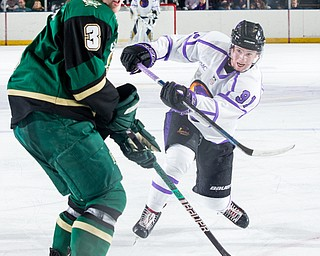 Scott R. Galvin   The Vindicator.Youngstown Phantoms forward Connor MacEachern (91) makes a shot for a goal during the first period past Sioux City Musketeers defenseman Luke Johnson (3) doing the second period at the Covelli Centre on Saturday, January 5, 2019.
