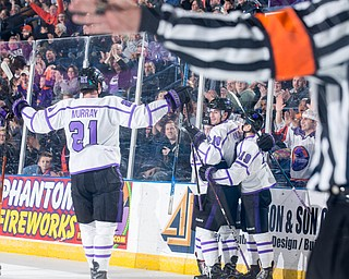 Scott R. Galvin   The Vindicator.Youngstown Phantoms forwards Brett Murray (21), Jack Malone (18) and Ben Schoen (19) congratulate Connor MacEachern on his second period goal against Sioux City Musketeers as the referee signals for a goal at the Covelli Centre on Saturday, January 5, 2019.