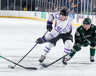 Scott R. Galvin   The Vindicator.Youngstown Phantoms forward Connor MacEachern (91) skates the puck past Sioux City Musketeers forward Ian Malcolmson (59) during the second period at the Covelli Centre on Saturday, January 5, 2019.