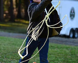CANFIELD, OHIO - JANUARY 5, 2019: Kyle Ramhoff throws a line during an ice rescue station, Saturday morning at Camp Stambaugh. DAVID DERMER | THE VINDICATOR