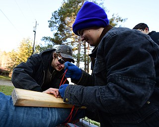 CANFIELD, OHIO - JANUARY 5, 2019: Kyle Ramhoff, front, and Austin Ladd work on putting on a make shift spent on the leg of Nick Martin, Saturday morning at Camp Stambaugh. DAVID DERMER | THE VINDICATOR