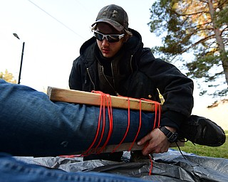 CANFIELD, OHIO - JANUARY 5, 2019: Nick Martin has his leg placed in a make shift spent by Austin Ladd, back, Saturday morning at Camp Stambaugh. DAVID DERMER | THE VINDICATOR