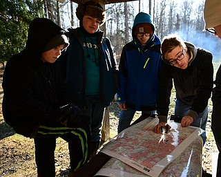 CANFIELD, OHIO - JANUARY 5, 2019: CANFIELD, OHIO - JANUARY 5, 2019: (RtoL) Dylan Jacobs uses a compass while Jonathan Oles, Dylan Hovanes and Dustin Jacobs watch, Saturday morning at Camp Stambaugh. DAVID DERMER | THE VINDICATOR