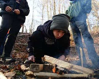 CANFIELD, OHIO - JANUARY 5, 2019: Nick Usis from Canfield works on starting a fire, Saturday morning at Camp Stambaugh. DAVID DERMER | THE VINDICATOR
