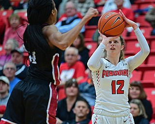 YOUNGSTOWN, OHIO JANUARY 5, 2019: Youngstown State's Chelsea Olson shoots a three point shot over IUPUI's Tamya Sims during the first half of their game, Saturday afternoon at Beeghly Center. Youngstown State won 70-52. DAVID DERMER | THE VINDICATOR