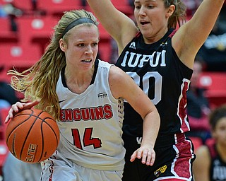 YOUNGSTOWN, OHIO JANUARY 5, 2019: Youngstown State's Melinda Trimmer drives on IUPUI's Agatha Beier during the first half of their game, Saturday afternoon at Beeghly Center. Youngstown State won 70-52. DAVID DERMER | THE VINDICATOR