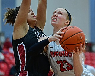 YOUNGSTOWN, OHIO JANUARY 5, 2019: Youngstown State's Sarah Cash goes to the basket against IUPUI's Macee Williams during the second half of their game, Saturday afternoon at Beeghly Center. Youngstown State won 70-52. DAVID DERMER | THE VINDICATOR