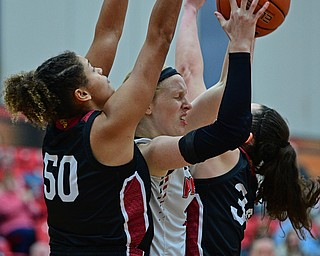 YOUNGSTOWN, OHIO JANUARY 5, 2019: Youngstown State's Sarah Cash looks to pass the ball while being pressured by IUPUI's Macee Williams, left, and Katelyn O'Reilly during the second half of their game, Saturday afternoon at Beeghly Center. Youngstown State won 70-52. DAVID DERMER | THE VINDICATOR
