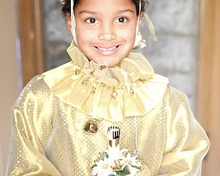 Eva Pandone, 7, of Liberty, dressed as a Christmas sprite poses for a photo before the beginning of the Boar's Head and Yule Log Festival at St. John's Episcopal Church on Sunday afternoon. EMILY MATTHEWS | THE VINDICATOR