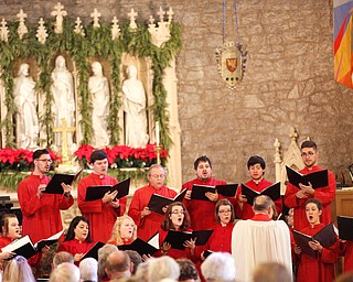 The St. John's Choir performs during the Boar's Head and Yule Log Festival at St. John's Episcopal Church on Sunday afternoon. EMILY MATTHEWS | THE VINDICATOR