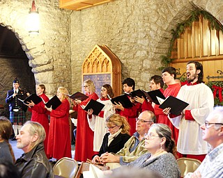 Member of the St. John's Choir perform in the back of the church during the Boar's Head and Yule Log Festival at St. John's Episcopal Church on Sunday afternoon. EMILY MATTHEWS | THE VINDICATOR