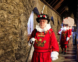 The beefeaters walk down the church aisles during the Boar's Head and Yule Log Festival at St. John's Episcopal Church on Sunday afternoon. EMILY MATTHEWS | THE VINDICATOR