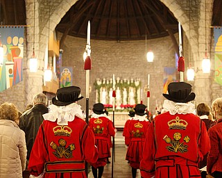 The beefeaters stand in the middle aisle of the church during the Boar's Head and Yule Log Festival at St. John's Episcopal Church on Sunday afternoon. EMILY MATTHEWS | THE VINDICATOR