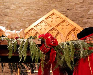 The boar's head is carried into the church during the Boar's Head and Yule Log Festival at St. John's Episcopal Church on Sunday afternoon. EMILY MATTHEWS | THE VINDICATOR