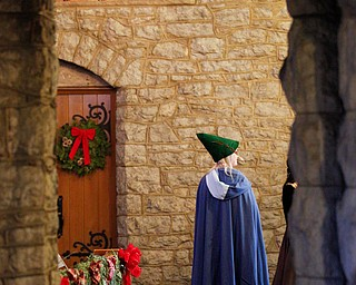 One of the waits stands near the front of the church during the Boar's Head and Yule Log Festival at St. John's Episcopal Church on Sunday afternoon. EMILY MATTHEWS | THE VINDICATOR