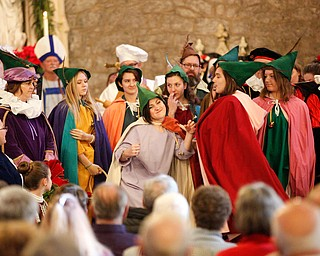 The waits perform the Twelve Days of Christmas during the Boar's Head and Yule Log Festival at St. John's Episcopal Church on Sunday afternoon. EMILY MATTHEWS | THE VINDICATOR