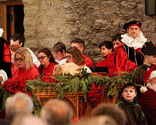 The boar's head is displayed on an alter during the Boar's Head and Yule Log Festival at St. John's Episcopal Church on Sunday afternoon. EMILY MATTHEWS | THE VINDICATOR